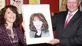 Andrea Martin poses proudly with the new portrait alongside Sardi's head Max Klimavicius.
