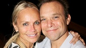 Kristin Chenoweth presents Norbert Leo Butz with a bouquet of the musical's signature flowers, daffodils!