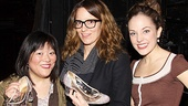 Does it fit? Ann Harada and Tina Fey check out Laura Osnes' sparkling glass slippers.