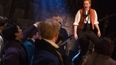 Mark Uhre as Enjolras and the cast of Les Miserables. Photo by Matthew Murphy