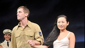 Onstage lovebirds Andrew Samonsky and Li Jun Li hold hands for their final show.