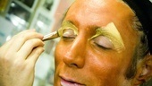 Yellow is applied to his eyebrows to brighten things up.