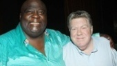 Michael Mandell throws his arm around co-star George Wendt. 