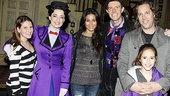 Emmanuelle Chriqui and her own familial entourage join Laura Michelle Kelly and Gavin Lee for a group shot.