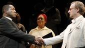 Chuck Cooper as Stephen Kumalo, Joy Lynn Matthews and Daniel Gerroll as James Jarvis in Lost in the Stars.