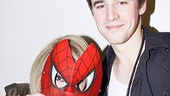 Who's that masked maven posing with Spider-Man star Reeve Carney?