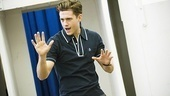 Aaron Tveit gets into character with a little song and dance.