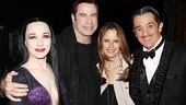 Talk about the perfect double date! John Travolta and Kelly Preston grab a photo with Morticia (Bebe Neuwirth) and Gomez (Roger Rees) to commemorate their visit with The Addams Family.