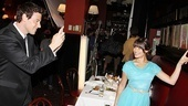 Cory Monteith snaps a shot of Lea Michele posing with the famed Sardis portraits of Broadway stars past and present.