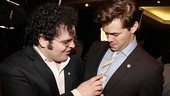 Josh Gad adjusts his Mormon co-star and fellow nominee Andrew Rannell's tie.