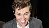 Elder Price (Tony nominee Andrew Rannells) flashes a cheery Mormon smile as he gives out some autographs.