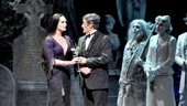 Brooke Shields as Morticia Addams, Roger Rees as Gomez Addams and cast in The Addams Family.