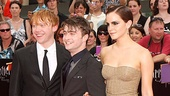 Rupert Grint, Daniel Radcliffe and Emma Watson (in a golden Bottega Veneta gown) celebrate their final collaboration in Harry Potter and the Deathly Hallows Part 2. Congrats!