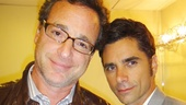 John Stamos gets a little backstage support from his Full House co-star, Bob Saget. 
