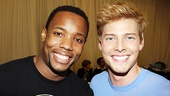 Judas (Wallace Smith) and Jesus (Hunter Parrish) pal around after giving the audience a sneak peek of Godspell.