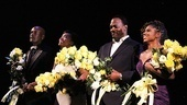 The Mountaintop team (director Kenny Leon, Katori Hall, Samuel L. Jackson and playwright Katori Hall) admire their congratulatory bouquets.