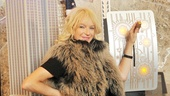 Looking super-stylish in a fall fur vest, Mamma Mia! creator and producer Judy Craymer shows off the magic switch that (symbolically) lights the Empire State Building in honor of her shows 10th Broadway birthday. 