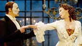 Hugh Panaro as the Phantom and Trista Moldovan as Christine in The Phantom of the Opera.