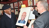 Samuel L. Jackson can't contain his excitement as he is presented with his portrait by Max Klimavicius of Sardi's.