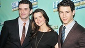 After the show, newly minted Broadway stars Michael Urie and Nick Jonas put their arms around Rose Hemingway.