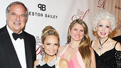 Kristin Chenoweth gets between Drama League benefit chairs Stewart F. Lane and Bonnie Comley and Drama League president Jano Herbosch.
