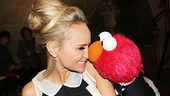 Aww! We want to rub noses with Elmo, too, Kristin!