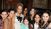 "The next generation of Broadway stars surrounds Kristin Chenoweth before singing ""My New Philosophy"" for the delighted honoree."
