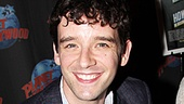 Michael Urie flashes a big smile while signing autographs at Planet Hollywood.