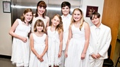 Grace Luckett, Charlotte Knutsen, Mary Michael Patterson, Natalie Hawkins, Jake Montagnino, Olivia Knutsen and Jacob Sutton line up for a Von Trapp family portrait.