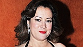 Jennifer Tilly is dressed to the nines in lacy Christian Louboutins.