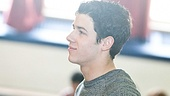 Nick Jonas observes the General D. Chappie James Middle School students in action.
