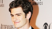 Death of a Salesman's Best Featured Actor nominee Andrew Garfield flashes a smile on the red carpet.