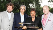 Al Pacino shows off his mounted sword in a photo with Public Theater artistic director Oskar Eustis, chairman of the board Warren Spector and executive director Patrick Willingham.