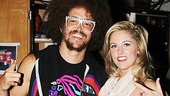 Redfoo and Bring It On star Taylor Louderman throw up a pair of ILY signs backstage.