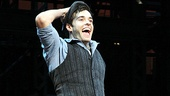 Seize the day, Corey! Cott runs forward for his first bow as the star of Newsies.