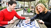 After their ride, the duo challenges each other to a friendly game of chess.