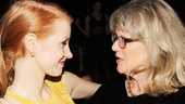 Jessica Chastain and Judith Ivey share a tender moment at the party.