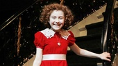 Annie's title star Lilla Crawford makes her big entrance down Warbucks' grand staircase.