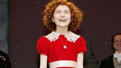 In her red wig and red dress, Lilla Crawford is the picture-perfect Annie.