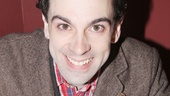 Rob McClure adds a finishing touch to the portrait: his autograph!