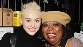 Miley Cyrus is all smiles with Chicago's Mama Morton, Carol Woods.