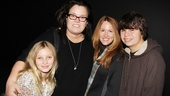 What a fabulous family! Vivienne gets some family love from her brother Blake, mom Rosie O'Donnell and her spouse, Michelle Rounds.