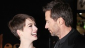 Anne Hathaway and Hugh Jackman share a laugh before the premiere.