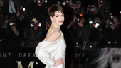 Anne Hathaway models her pearl-encrusted Givenchy Couture gown. 