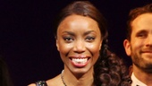 A radiant Heather Headley smiles through tears. 
