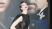 Always the drama queen, Anne Hathaway makes a goth fashion statement in a Tom Ford taffeta gown and custom-made gladiator sandals.