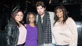 Gabby Douglas takes her sister Arielle Hawkins (far left) and mother Natalie Hawkins (far right) backstage to meet the show's leading man, Billy Ray Cyrus.