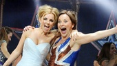 Geri Halliwell shares a joyful moment on stage with Sally Ann Triplett.