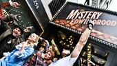 Outside at Studio 54, the cast members of Edwin Drood rep their show below the marquee.