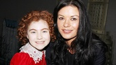 Annie's title star Lilla Crawford and Oscar and Tony winner Catherine Zeta-Jones pose cheek-to-cheek at the Palace Theatre.